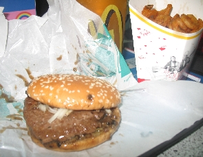 My Prosperity Burger Set (with black pepper sauce splattered all over); curly fries and cold green tea. Nice.