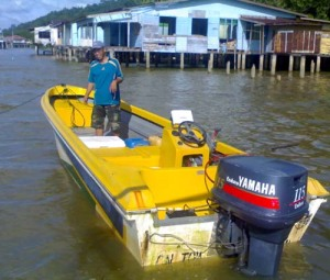 My brother-in law and his 115 horsepower boat. Fishing is part of his life. He ferried us across to Sungai Bunga.