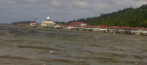 Kampong SUngai Bunga resettlement from a distance. Pic taken from a boat, the only way to go across.