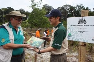 David Taylor (left) presenting a souvenier book, Nomads of the dawn to His Excellency for the high commissioner's support to the ISB's Million Trees project. Look at the High Commissioner's hands.